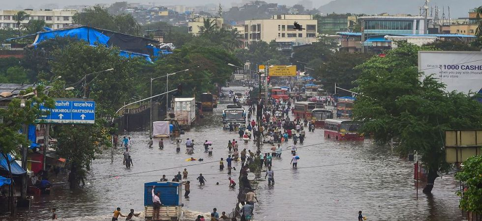 A view of the waterlogged LBS road after the water level of Mithi river rose due to incessant monsoon rains in Mumbai (Photo Source: PTI)
