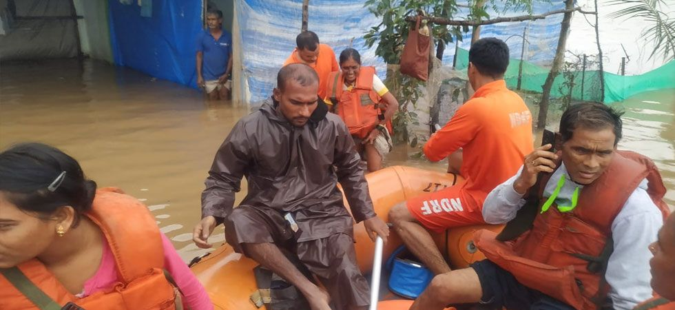 Boats were deployed to rescue around 400 people stranded in the Kurla suburb. (Image Credit: ANI)