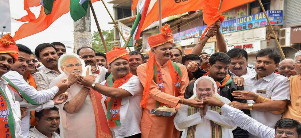 BJP members celebrate scrapping of Article 370, 35A in Jammu and Kashmir (Photo Source: PTI)