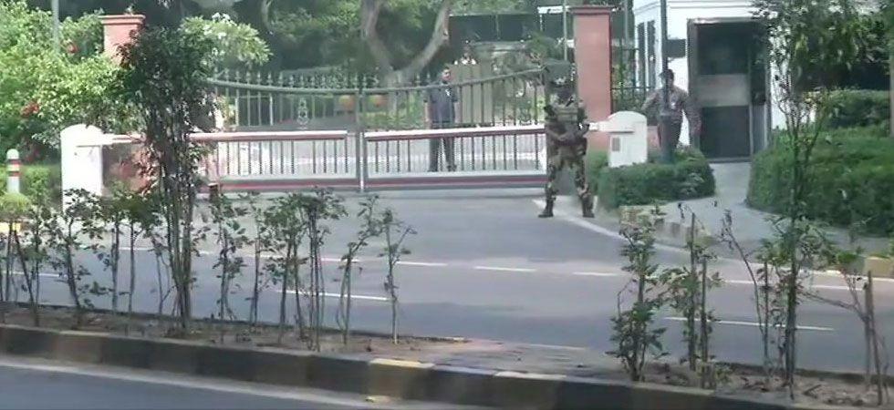 CRPF personnel patrolling a street as Kashmir remain tensed. (Image Credit: ANI)