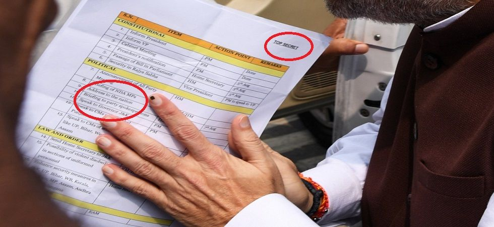A photo of documents kept between Amit Shah's folded hands, as he walked into Parliament on Monday morning, drew a huge attention. (Twitter)