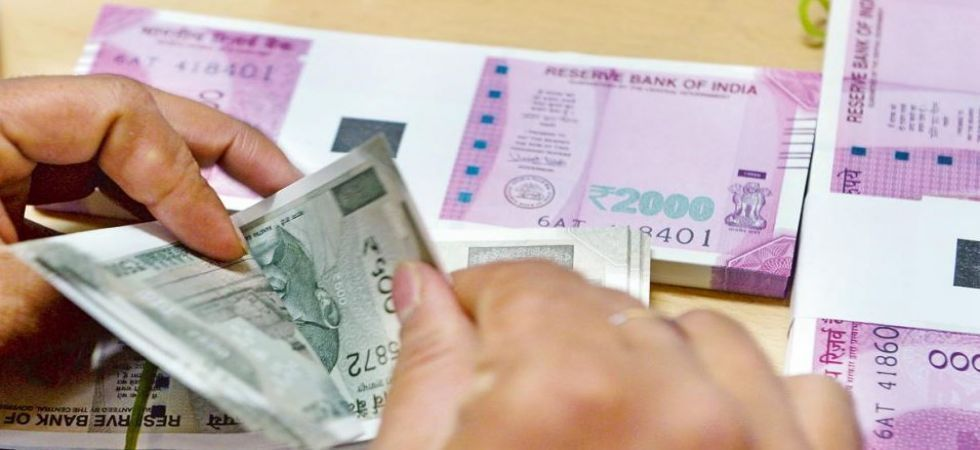 Forex traders said rupee is trading in a narrow range tracking cautious opening in domestic equities