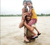Man carries two kids on shoulders for over 1.5 km in flood-hit Gujarat, wins accolades