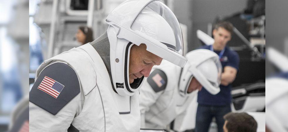 NASA astronaut Doug Hurley trying on the SpaceX suit. Image: NASA