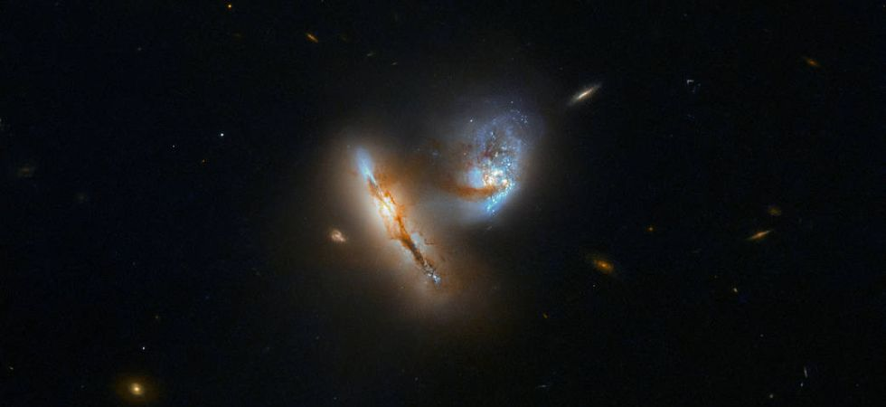 Hubble snaps two galaxies charging towards each other (Photo Credit: ESA/Hubble & NASA, A. Evans)