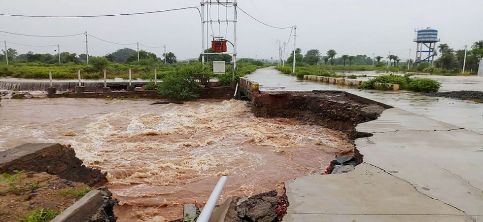A damaged road after heavy monsoon downpour in Mandsaur (Photo Source: PTI)