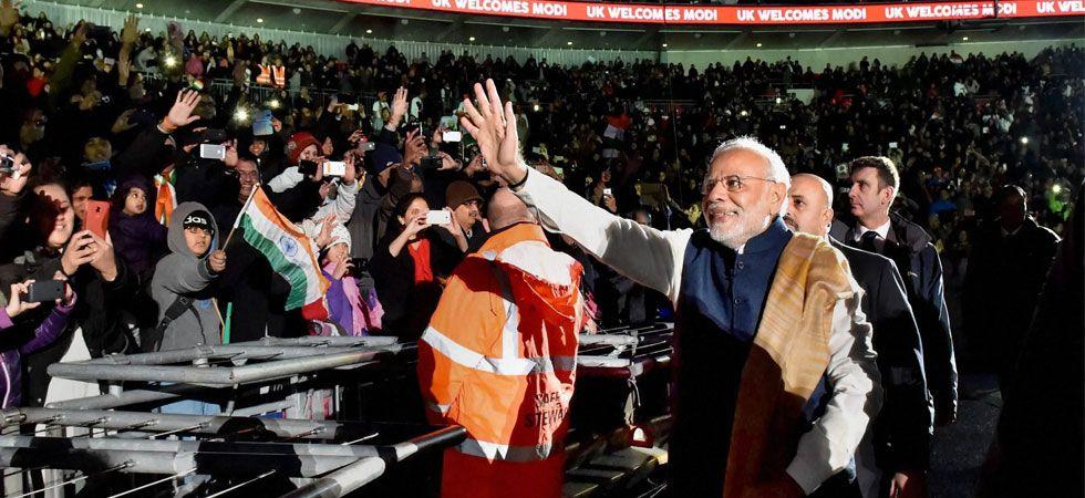 Prime Minister Narendra Modi greeting people during his one of UK visits. (Photo: File/PTI)