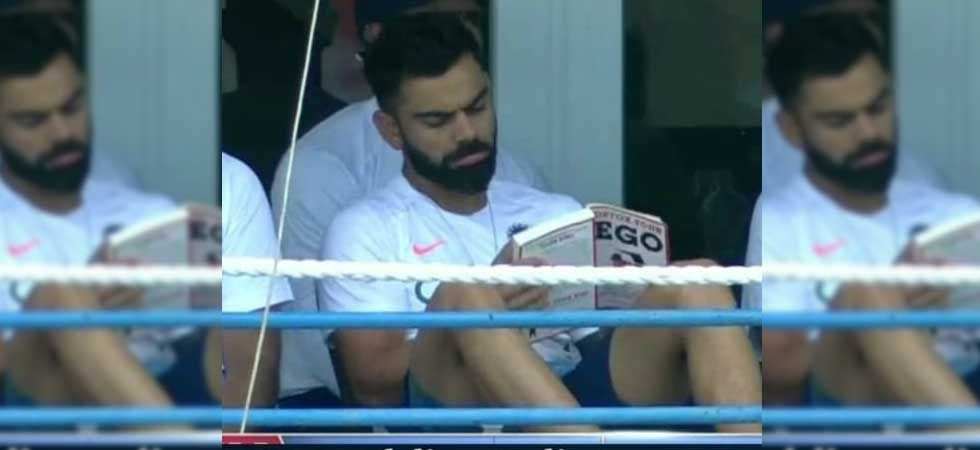 Viral photo of Virat Kohli reading a book during India vs West Indies Test. (Photo: Twitter)