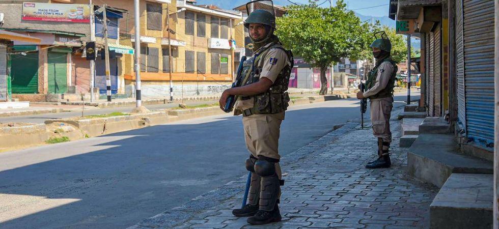 CRPF personnel stand guard in a street in Srinagar (Photo Source: PTI)