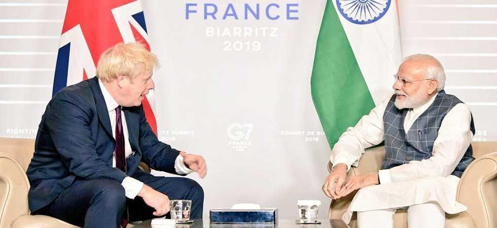 Prime Minister Narendra Modi with his British counterpart Boris Johnson. (Photo: Twitter/@MEAIndia)