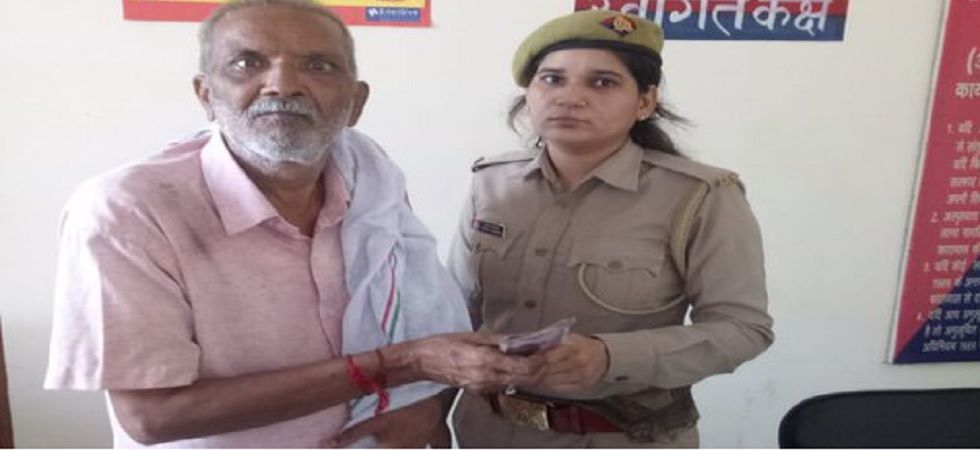 The elderly man with a police personnel. (Noida Police)