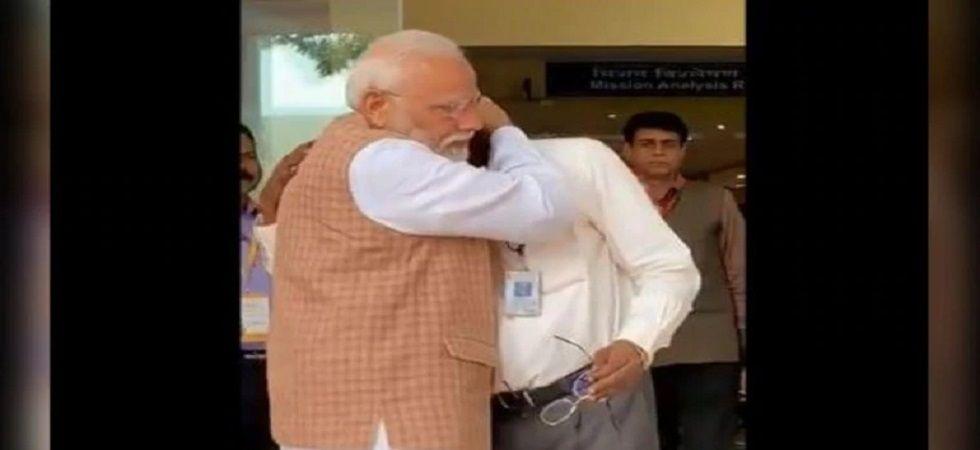 Prime Minister Narendra Modi hugs ISRO chief K Sivan. (ANI)