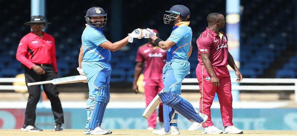 Virat Kohli and Rohit Sharma celebrating their 50-run stand during Oval ODI against West Indies. (Photo: Twitter/@BCCI)