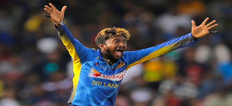 Akila Dananjaya was called for a suspect action for the second time within a year and that has prompted the ICC to ban him for bowling for one year. (Image credit: Twitter)