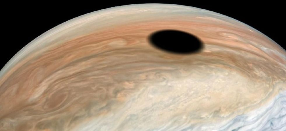 NASA's Juno spacecraft has stunned scientists after new images show a massive black hole on the surface of Jupiter (Photo: NASA)