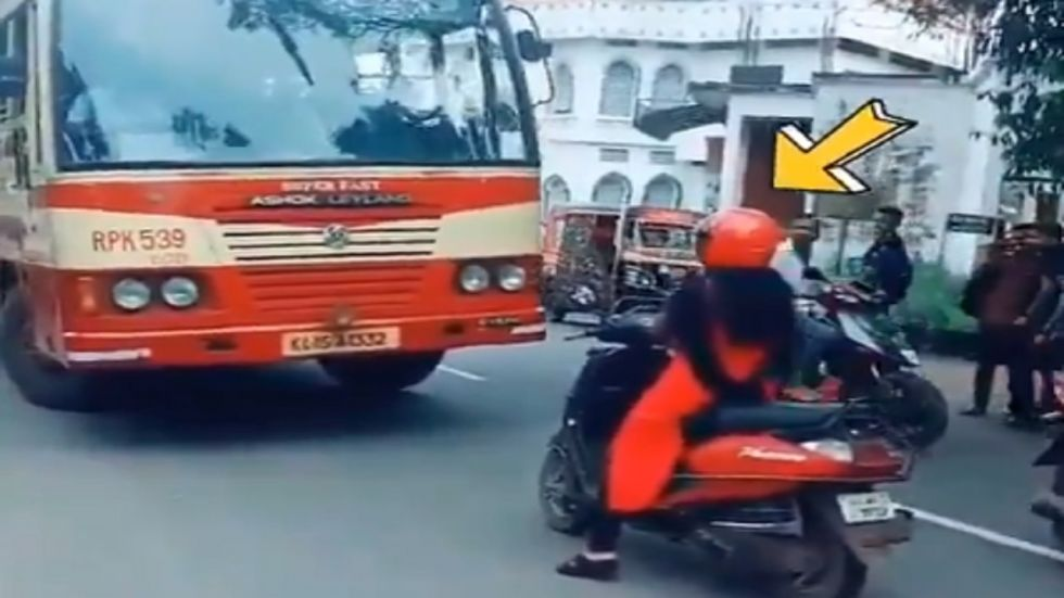 WATCH: Woman On Scooty Forces Bus Driver To Take Right Lane (Twitter)