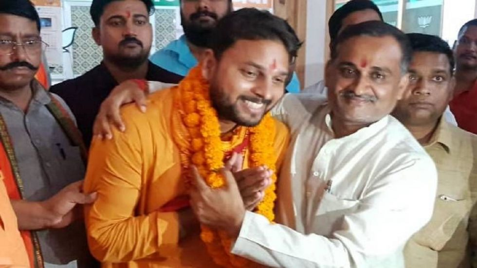 BJP's Ghosi candidate and vegetable vendor Nand Lal Rajbhar's son Vijay Rajbhar (Photo Source: ANI)