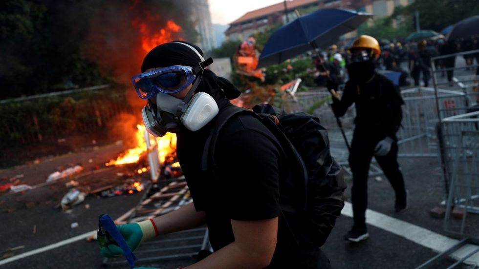 An anti-government protester carries a molotov cocktail during a demonstration in Sha Tin district, on China's National Day in Hong Kong on Tuesday. (Reuters photo)