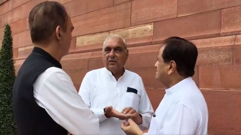 A still of Ahmed Patel (right), Bhupinder Singh Hooda (centre) and Ghulam Nabi Azad from the leaked video.