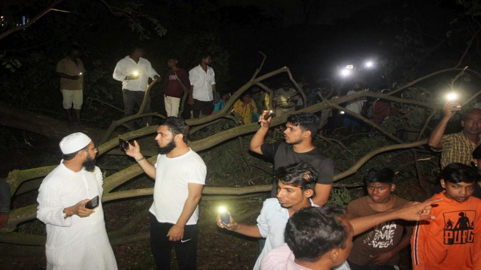 People gathered in protest at Aarey Forest against felling of trees there late Friday night