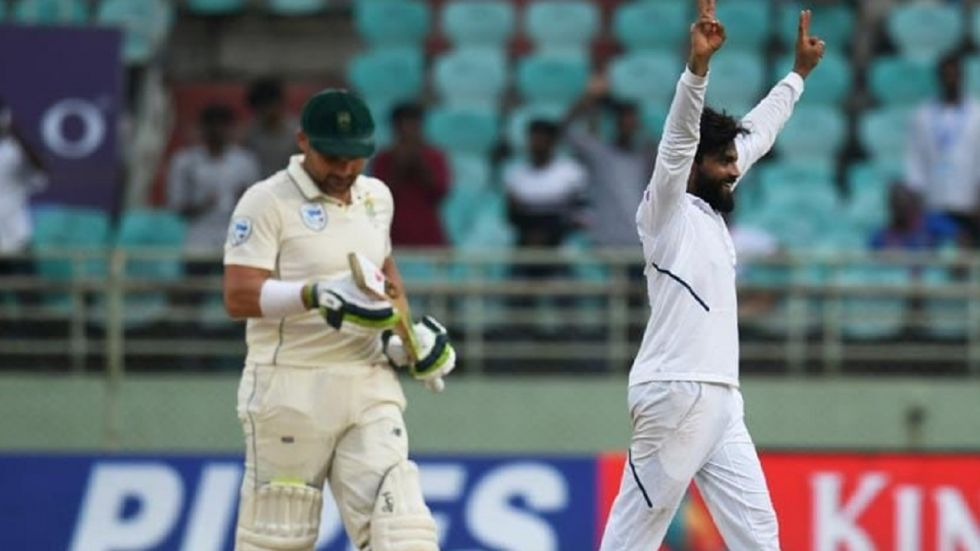 Ravindra Jadeja took the wicket of Dean Elgar after Rohit Sharma blasted two centuries in the same Test to put India on top.