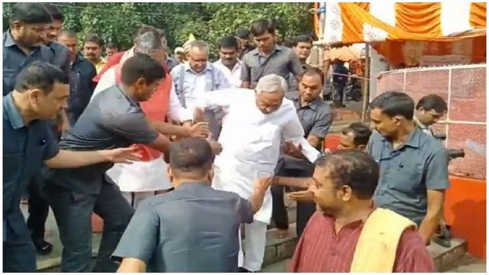 Chief Minister Nitish Kumar escaped unhurt as alert security guards saved him from falling on the floor.