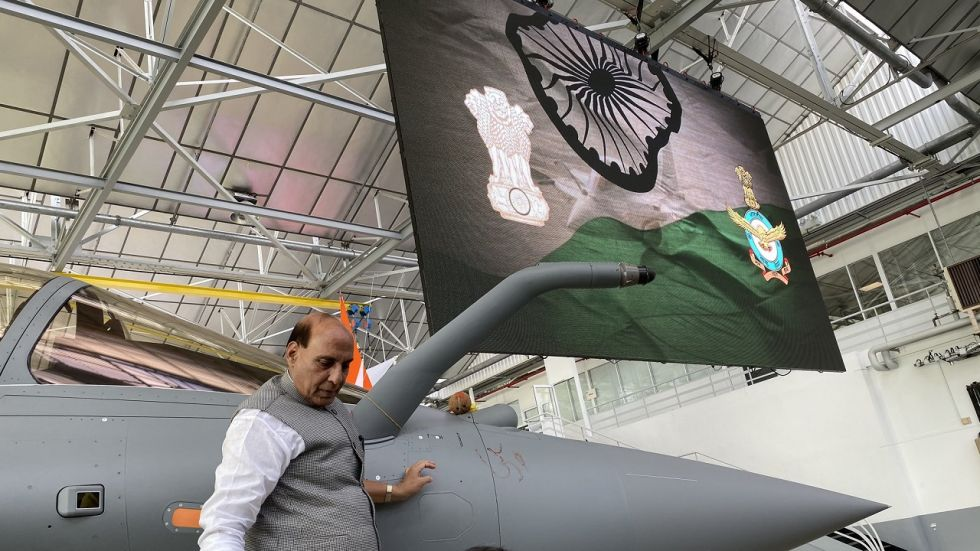 Rajnath Singh emblazoned the aircraft with an 'Om' tilak and laid flowers and a coconut on Rafale jet.
