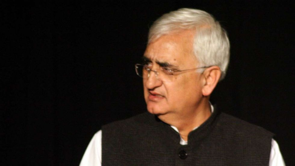 Congress leader Salman Khurshid has targetted those who 'walked away' from Congress when 'the chips were down'