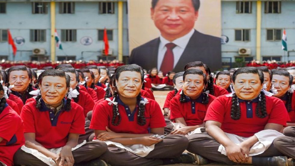 School students wear masks of Chinese President Xi Jinping in Mamallapuram ahead of his visit.