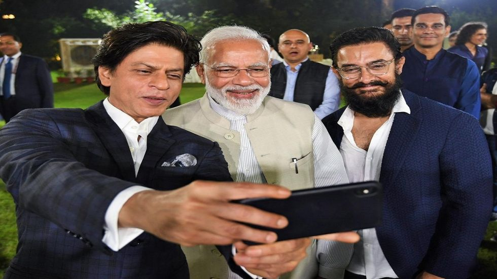 Aamir Khan and Shah Rukh Khan take a selfie with PM Narendra Modi in Delhi.