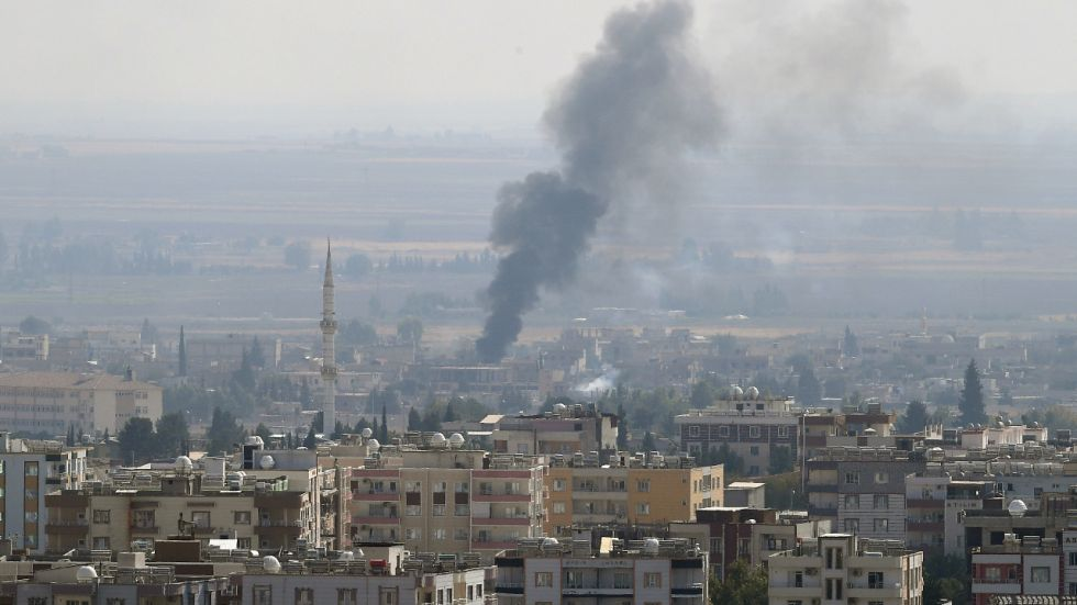 Photo taken from Turkish border town of Ceylanpinar on October 17, 2019 shows smoke rising from the northern Syrian town of Ras al-Ain during an attack launched by Turkish army.