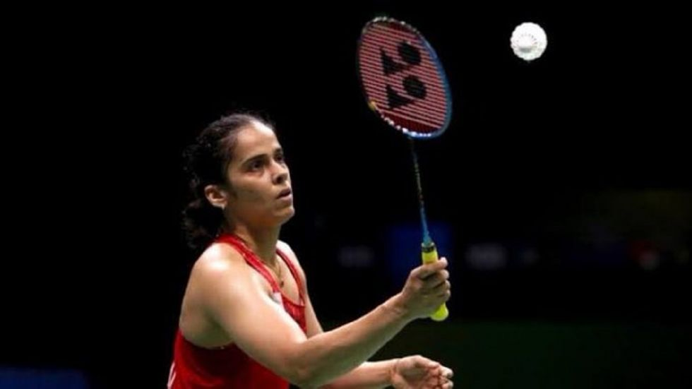 Saina Nehwal crashed out of the Paris Open as she 20-22 21-23 to world no 16 Young after a 49-minute thrilling contest.