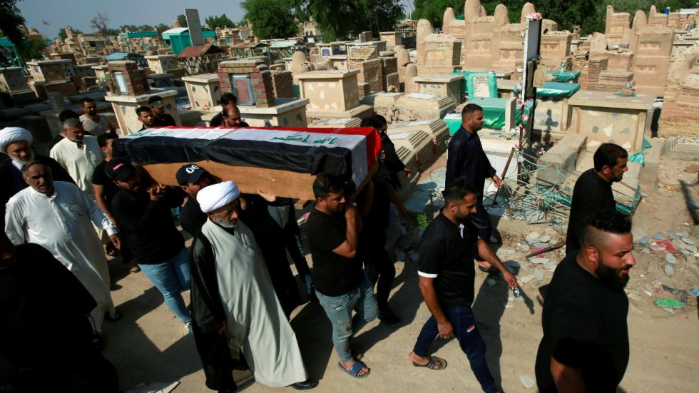 Mourners carry the coffin of a protester, who was killed at protests in Baghdad, during a funeral at a cemetery in the holy city of Najaf.