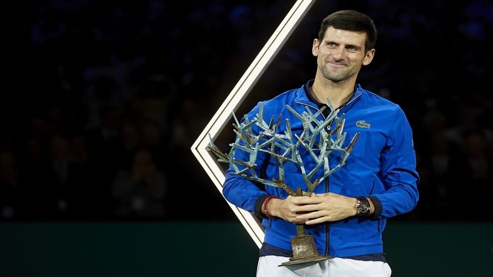 Novak Djokovic eased to a record-extending fifth Paris Masters title by brushing aside Canadian youngster Denis Shapovalov in Sunday's final.
