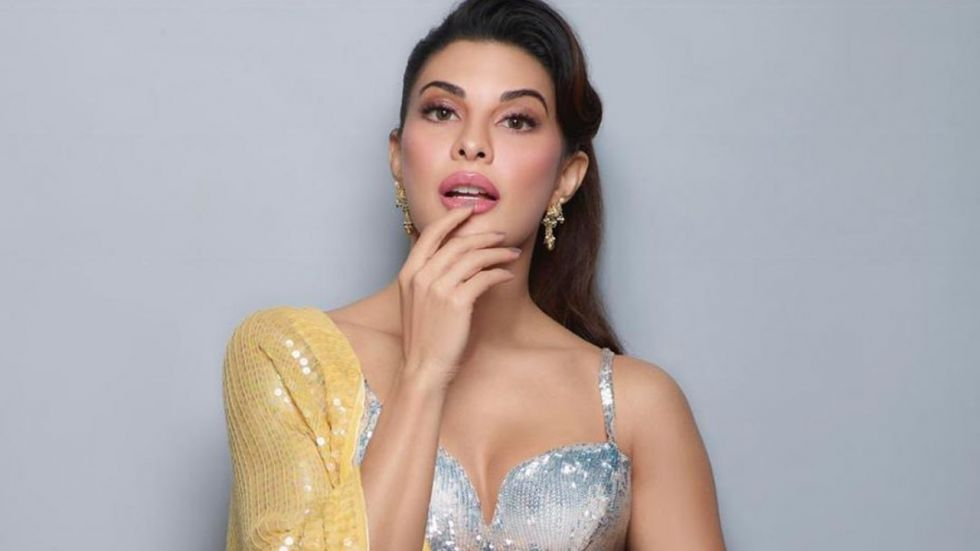 Jacqueline Fernandez Sizzles In Yellow Sequined Saree And Strappy Blouse
