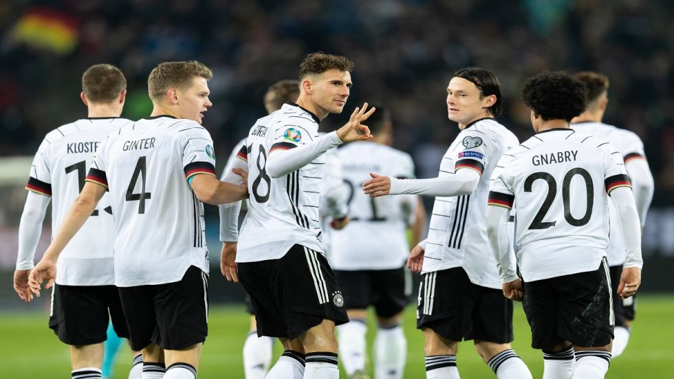 Germany moved to the top as Toni Kroos hit a brace in a simple 4-0 win over Belarus in Moenchengladbach which saw them qualify for the Euros for the 13th time in a row.