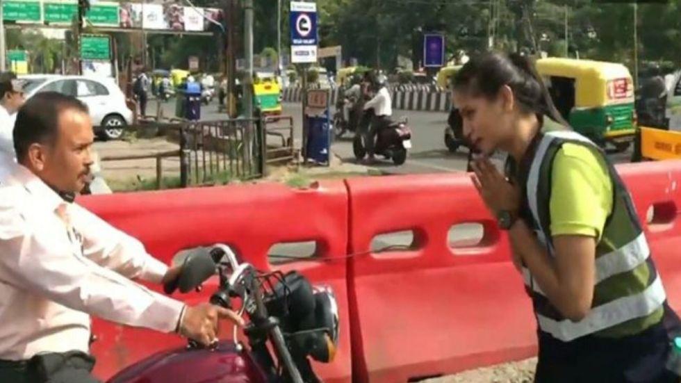 Shubhi Jain, who hails from Bina in Madhya Pradesh's Sagar district, has been asking riders to wear helmets.
