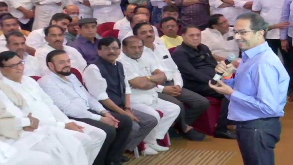 Shiv Sena chief Uddhav Thackeray addresses MLAs at Grand Hyatt Hotel.