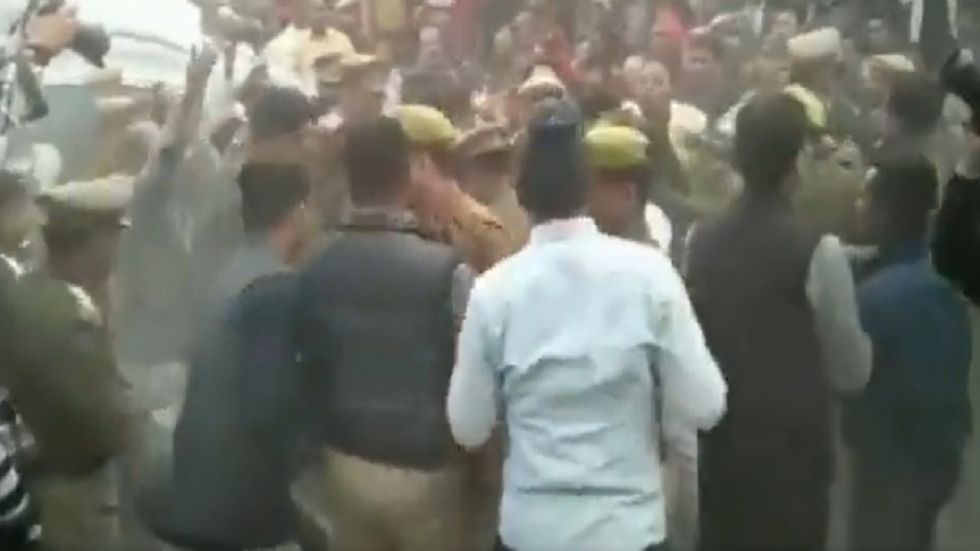 Uttar Pradesh police removing people who were protesters over the Unnao rape case.