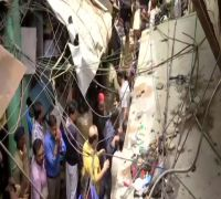 Rescuers remove debris with bare hands as 100-year-old building collapses in Dongri