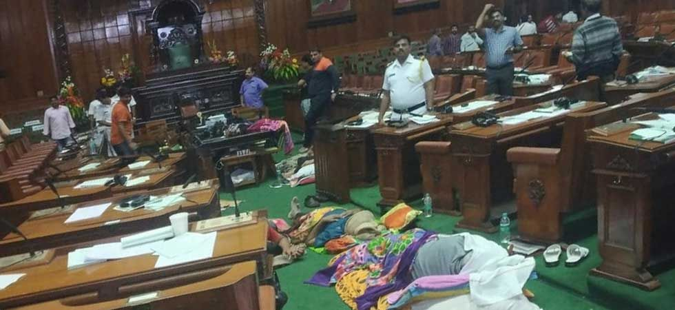 BJP MLAs sleeping inside the state Assembly after the House was adjourned without trust vote.