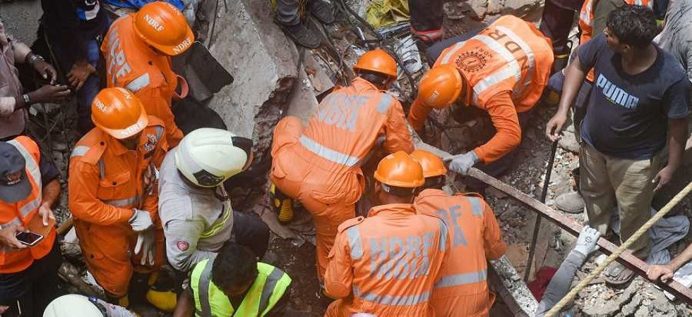 TV channels showed dramatic visuals of a child, wrapped in a cloth bundle, being carried out of the debris by rescue workers. (Image Credit: PTI)