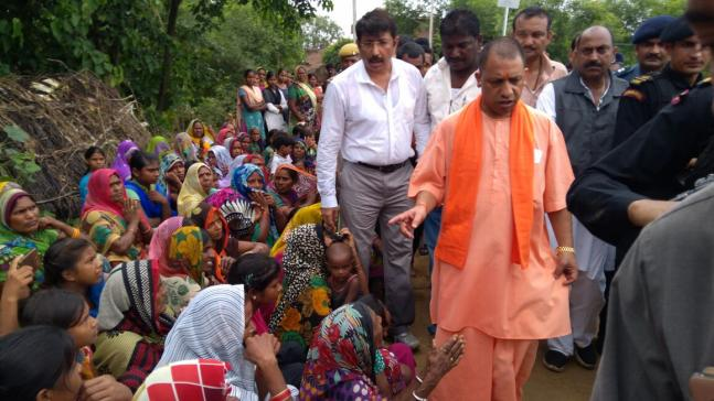 UP CM Yogi Adityanath visits flood affected Gorakhpur distributes food material to locals See pics
