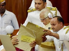 UP Assembly session GST bill tabled amid uproar by opposition papers thrown at Governor Ram Naik