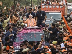 Modi in Varanasi Sea of humanity throngs to street as PM holds roadshow, performs Ganga Aarti in temple town
