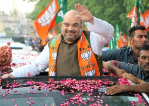 Karnataka Elections: Watch BJP president Amit Shah holds road show in Davanagere