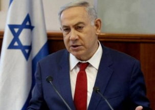 Israel Prime Minister Benjamin Netanyahu serves dessert to Shinzo Abe in a shoe