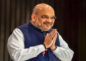 BJP chief Amit Shah urges people to vote for India's development