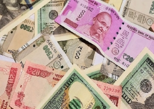 Rupee touches new low at 73.77 against US dollar