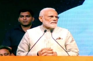 PM Narendra Modi addresses traders in Talkatora stadium